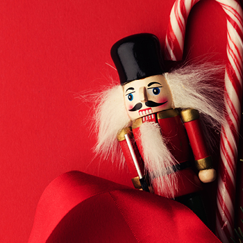 advertisement photo of nutcracker and candy cane
